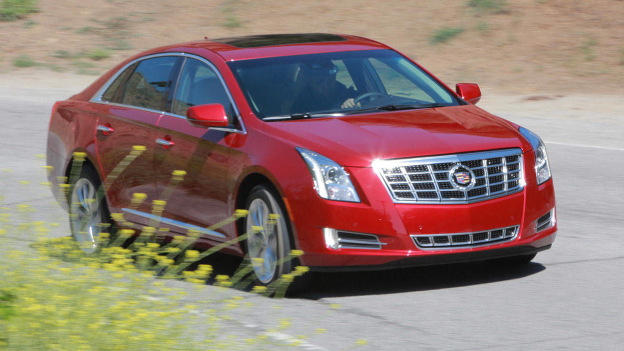 2013 cadillac xts specs photos price 2013 cadillac xts sedan first drive. Black Bedroom Furniture Sets. Home Design Ideas