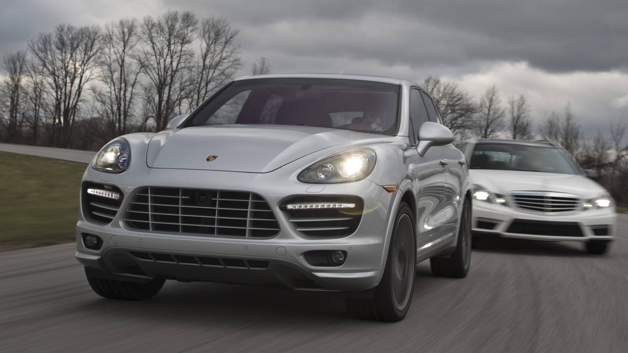 Comparison porsche cayenne turbo vs mercedes benz e63 amg for Mercedes benz compare